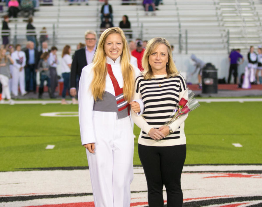 Senior Audrey Livingston celebrates four years of success in high school band at Senior Night Football  at Argyle High School in Argyle, Texas, on November 2, 2018. (Hannah Wood / The Talon News)