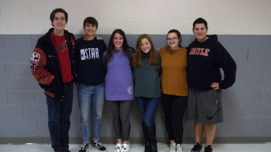 Pictured from left to right are the All State Choir Students: Jackson Barnes, Wade Paquin, Sarahbeth Meraz, Bella Zindel, Kassidy Rosengren and Payton Connatser (not pictured are Grady Henexson and Austin Rusk) at Argyle High School in Argyle, Texas, on Dec. 17, 2018. (Ashlynn Roberts  / The Talon News)