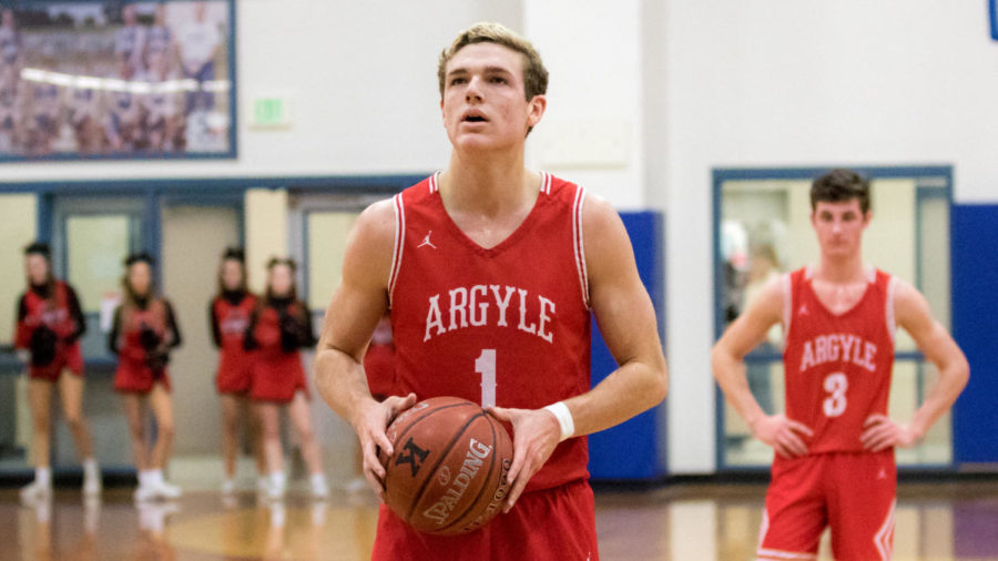 Senior+Brandon+White+prepares+to+shoot+a+basket+at+the+Eagles+vs+Bobcats+game+on+Jan.+14%2C+2019+at+Argyle+High+School.+%28Jacob+Lormand+%2F+The+Talon+News%29