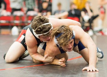 Isaiah Sheets, breaks down  opponent in the regional tournament. (Katy McBee/The Talon News)