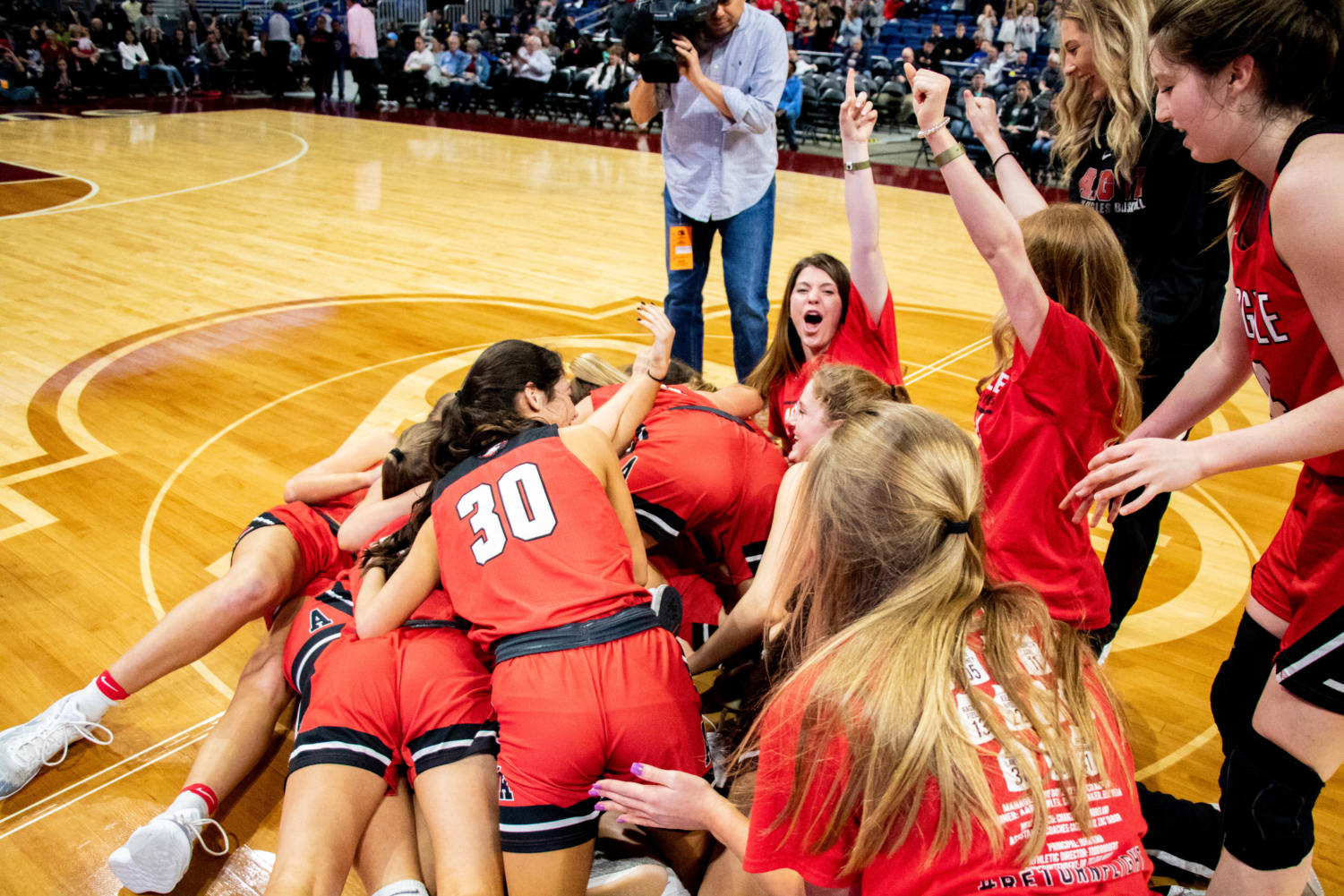 The Lady Eagles dogpile in center-court after they win the UIL Conference 4A State Championship game against Hardin-Jefferson at the Alamodome on March 3, 2019. (Campbell Wilmot/ The Talon News).