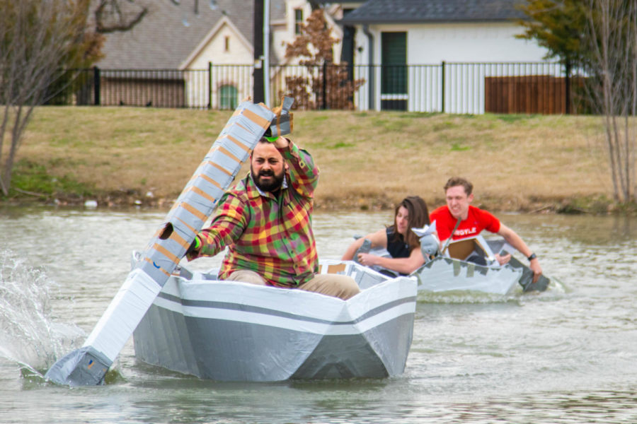 Mr. Allen struggles, as he tries to beat the AP Physics class boat on Feb. 26, 2019. (Campbell Wilmot/ The Talon News).