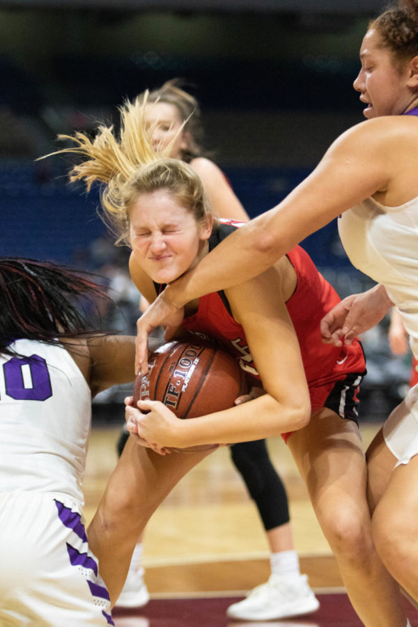 Though injured, junior Kiley Lavelle grabs a hard fought rebound as the Lady Eagles win the UIL Conference 4A State Semi-Final game against Dallas Lincoln at the Alamodome on Feb. 19, 2019. (Campbell Wilmot/ The Talon News).