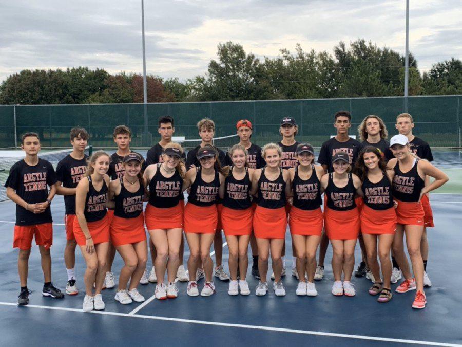 The Tennis Team poses after winning the Bi-District championship. (Photo courtesy of Tobi Jordan)