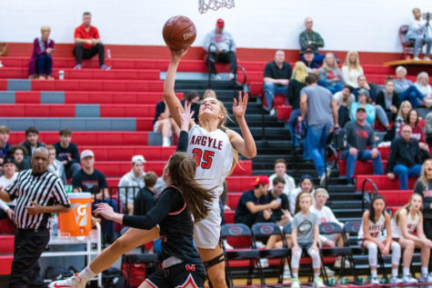 The Lady Eagles Shelby Henches (35) goes up for two as the Eagles go head to head with the Melissa Cardinals At Argyle High School in Argyle, Texas on Dec. 2, 2019. (Alex Daggett/ The Talon News)