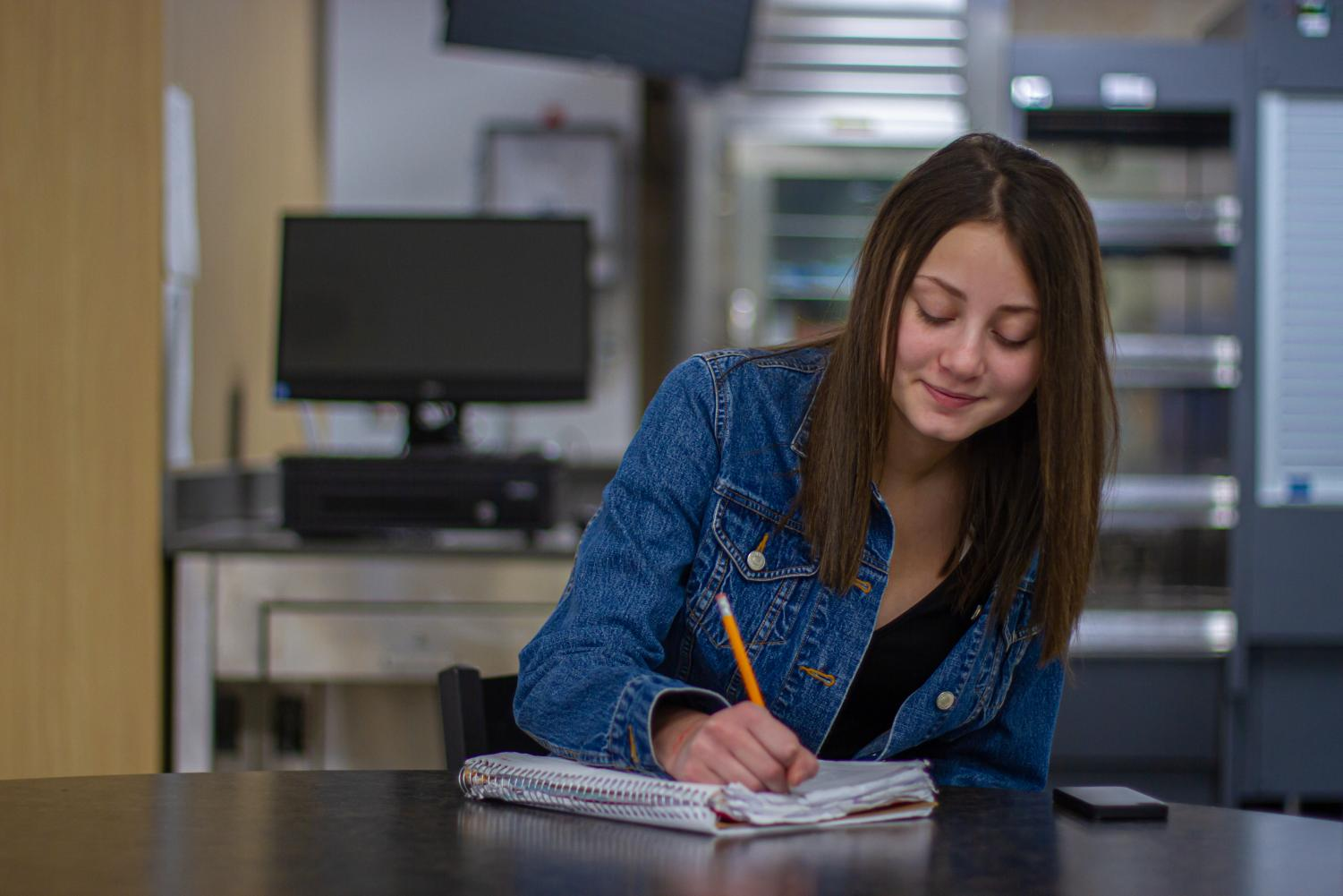 Estelle Brower journals her  experiences as a way of overcoming the past. (Emma Campbell / The Talon News)