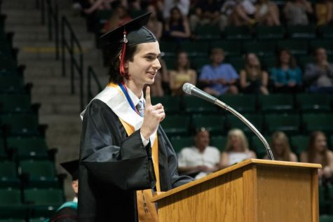 Valedictorian of the 2019 graduating class, Timothee Davis, giving his speech at graduation on May 21, 2019 at the UNT Coliseum. (Jaclyn Harris / The Talon News)