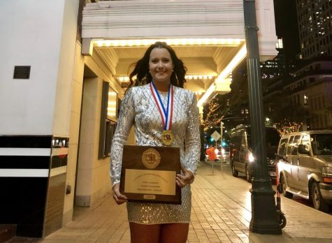 Senior Campbell Wilmot poses with her Division 1 Plaque at the UIL State Film Festival. (Stacy Short | The Talon News)