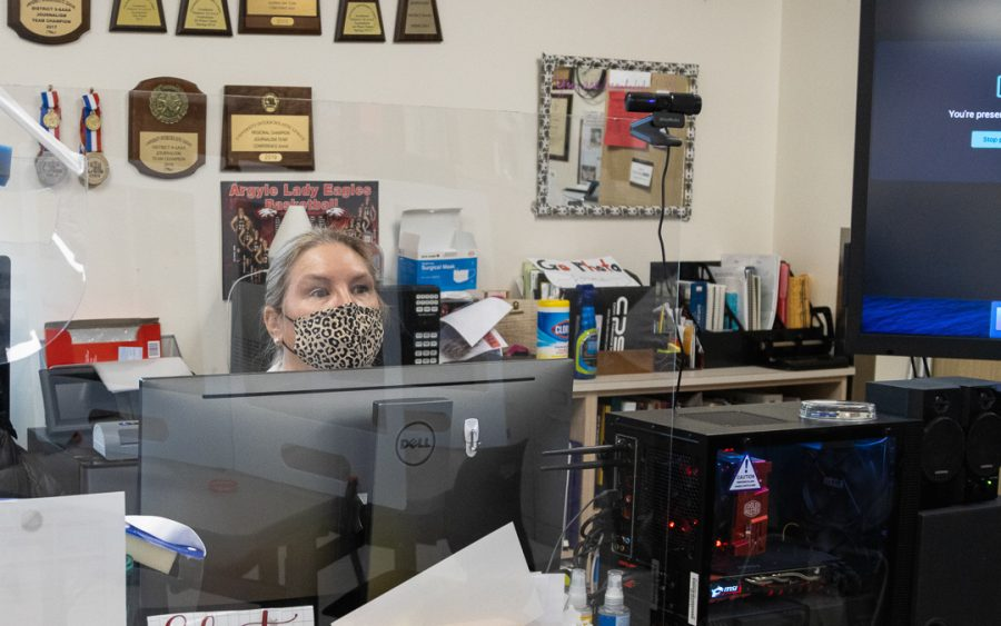 Teacher Stacy Short looks out at her face to face class as her virtual learners view through the lens of the camera.  (The Talon News | Nicholas West)