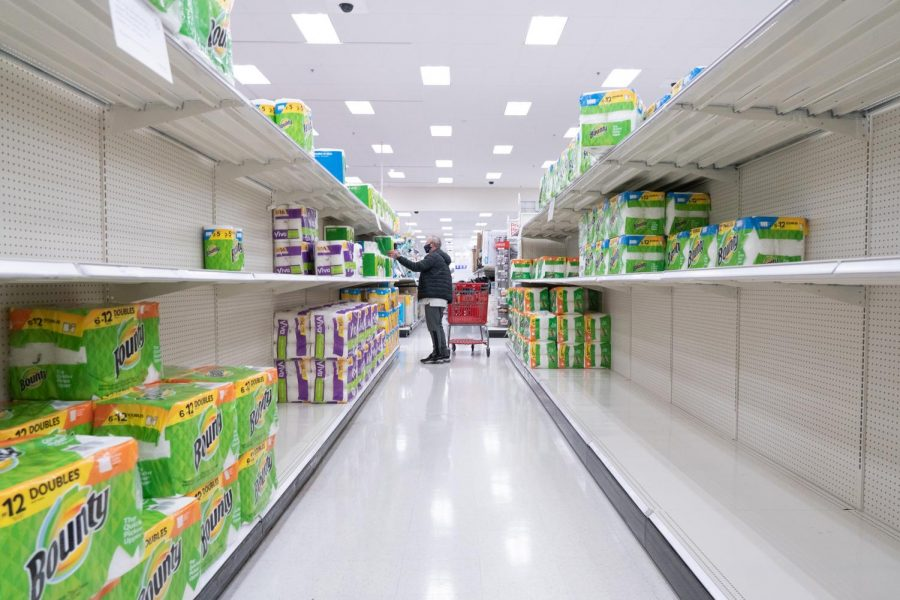 A shopper adds towels to his cart as supplies quickly dwindle at a Target in Flower Mound, Texas on Feb. 20, 2021. (Nicholas West / The Talon News)