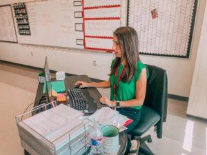 Freshman English teacher Melanie Henderson works at her desk. (Cate Clark | The Talon News)