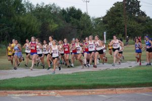 The Lady Eagles Varsity Cross Country team starts off strong at the Kennedale Invitational on Saturday, August 20th. (Natalie Long)