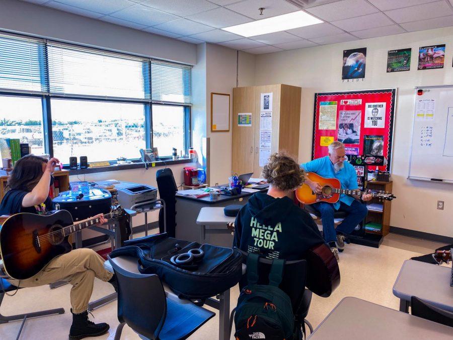 Students meet for guitar club during mega lunch. (Dylan Hilburn | The Talon News)